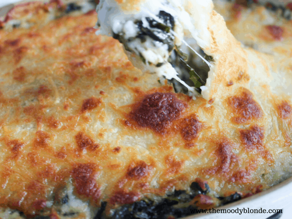 Easy Cheesy Spinach Artichoke Dip finished with bubbly golden brown mozzarella topping and stretching cheese